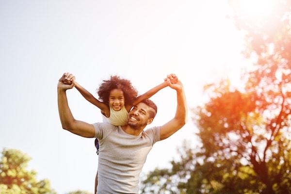Father carrying daughter piggyback